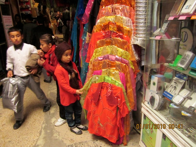 This little girl is eyeing up the fancy dresse, along with the whole of Kurdistan; Nawroz (Kurdish New Year) is coming up and everyone needs (fancy and shiny for girls) new clothes.