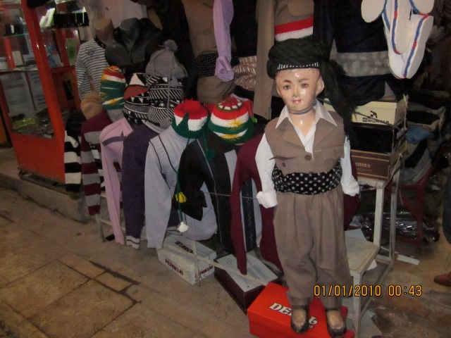 I was taking a photo of this little manequin, just for the outfit and a young boy from inside the shop came out...