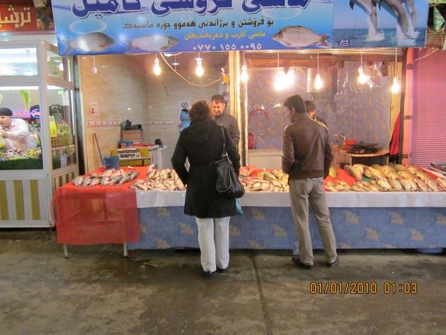 Jill shopping for fresh fish.