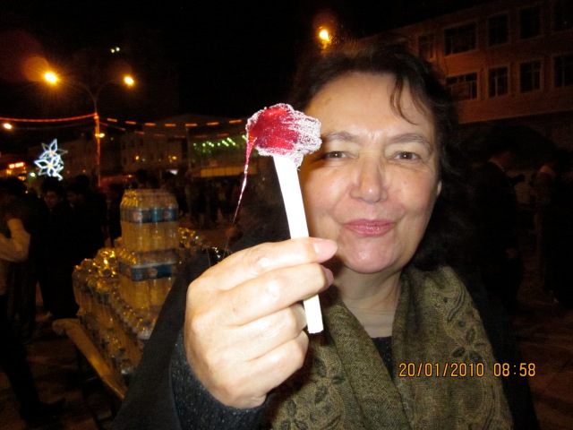 Jill holds up a sticky sweet on a stick that a vendor had given us to try.