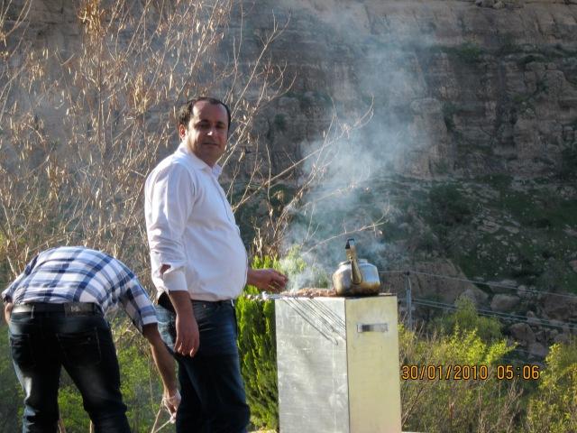 Karzan minding the tea and meat