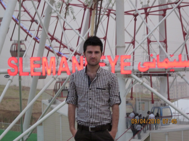 Zherou in front of The Slemani Eye, biggest ferris wheel in the Middle East.