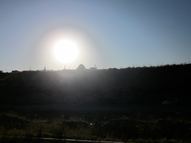The sun coming up over a mosque from our vantage on the river walk.