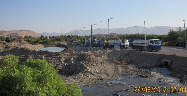 Dammed River with trucks