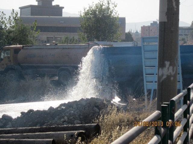 They back up to these stations where they can connect a hose coming from the river into the backs of their trucks and fill it to the brim, until it begins splashing over.